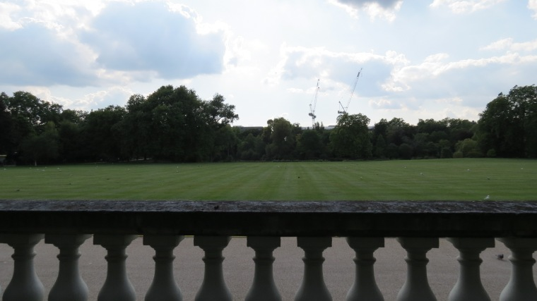 An image of the green back lawn of Buckingham Palace taken from the back balcony.