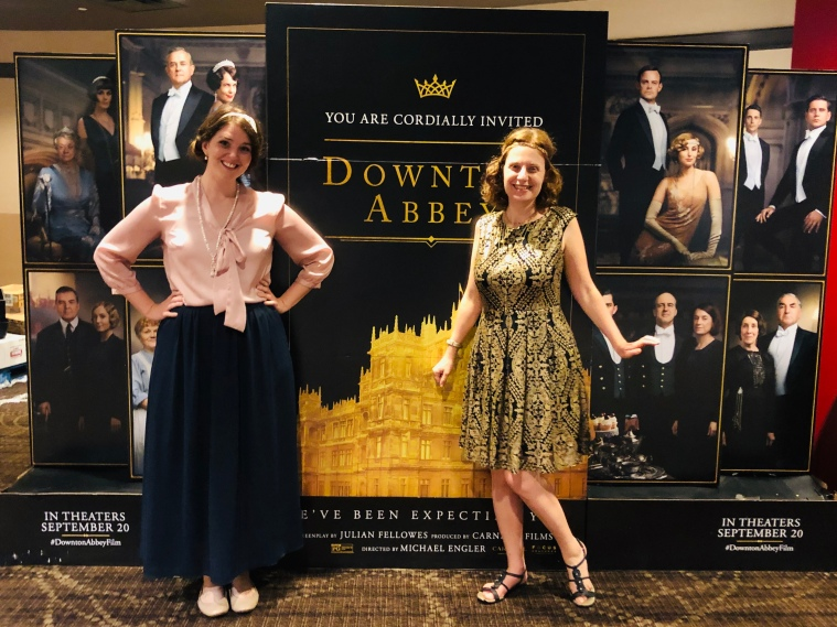 Two girls wearing Downton Abbey-inspired outfits at a special fan film event for the Downton Abbey movie.
